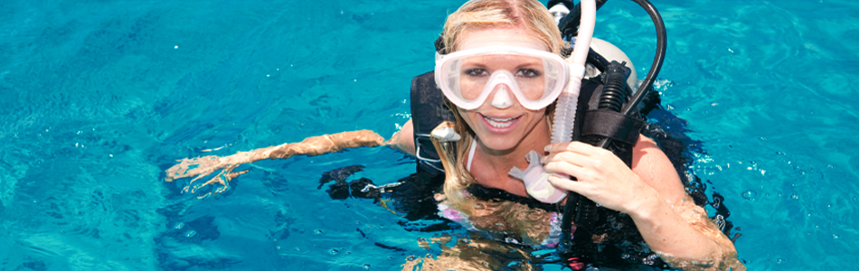 Smiling woman on the surface preparing for SCUBA dive